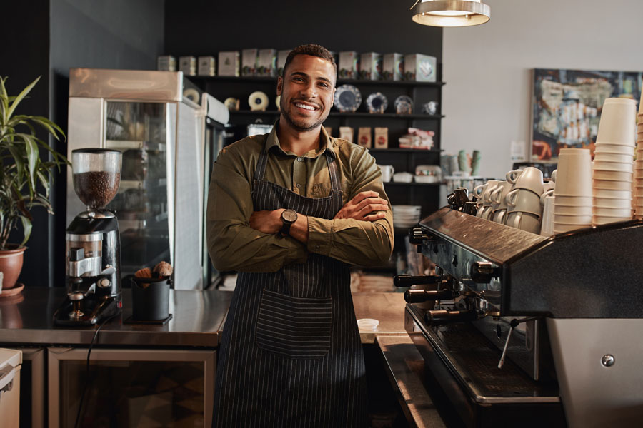 Business Insurance - Small Business Owner Looking Out After His Shop