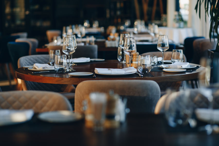 Specialized Business Insurance - Restaurant Set Up for Dinner with Afternoon Light